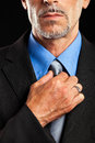 Businessman adjusting collar Royalty Free Stock Photography