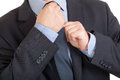 Businessman adjusting his tie close up of a Royalty Free Stock Photography