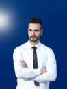 Businessman against blue background