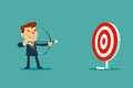 Businessman aiming target with bow and arrow Royalty Free Stock Photo