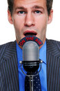 Businessman On the Air microphone Royalty Free Stock Photo