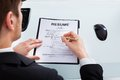 Businessman analyzing resume at office desk cropped image of in Royalty Free Stock Images
