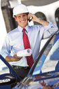 Businessman Architect In Hard Hat On Cell Phone Royalty Free Stock Photo