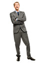 Businessman arms folded smiling isolated white background happy young business man full length Stock Photography