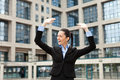Businessman with arms outstretched Stock Photography