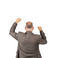 Businessman with arms raised celebrating victory rear view of mature isolated over white background Stock Photography