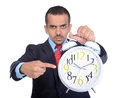 Businessman asian portrait of a young shows his finger to the big alarm clock isolated on white background Royalty Free Stock Photo