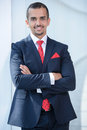 Businessman asian portrait of a young standing in office Royalty Free Stock Images