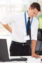 Businessman back pain having lower in office Royalty Free Stock Images