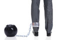 Businessman With Ball And Chain Attached To Leg Royalty Free Stock Photo