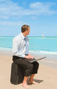 Businessman  on the beach Royalty Free Stock Photo