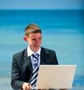 Businessman at the beach with noutbukom sevastopo l crimea Royalty Free Stock Photos