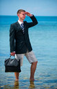 Businessman at the beach with noutbukom sevastopo l crimea Royalty Free Stock Images