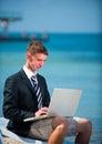 Businessman at the beach with noutbukom sevastopo l crimea Stock Image