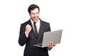 Businessman beeing a winner with laptop in his hands isolated Royalty Free Stock Photos