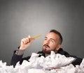 Businessman behind crumpled paper