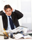 Businessman being overloaded with loads of work Stock Images