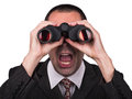 Businessman with binoculars Royalty Free Stock Photo