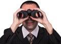 Businessman with binoculars Royalty Free Stock Photo