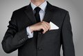 Businessman in black costume tie one's necktie Royalty Free Stock Photography