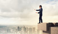 Businessman in blindfold image of standing on top of building Royalty Free Stock Photos