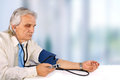 Businessman with bloodpressure and hospital Stock Photos