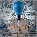 Businessman with blue light bulb head as concept Royalty Free Stock Photos