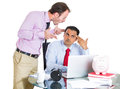 Businessman boss yelling having an argument with his employee over a project he is working hard on and about to explode portrait Stock Photos