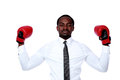 Businessman with boxing gloves raised his hand over white background Stock Photography