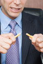 Businessman breaking pencil Royalty Free Stock Photo