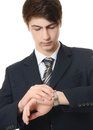 The businessman in a business suit looks at watch Stock Images