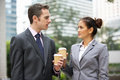 Businessman And Businesswoman Chatting In Street Royalty Free Stock Image