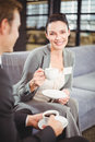 Businessman and businesswoman having tea during breaktime a discussion in office Stock Image