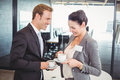 Businessman and businesswoman having tea during breaktime in office Royalty Free Stock Photos