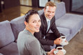 Businessman and businesswoman having tea during breaktime portrait of in office Stock Images