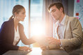 Businessman and businesswoman interacting using digital tablet Royalty Free Stock Photo