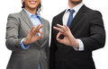 Businessman and businesswoman showing ok sign Royalty Free Stock Photo