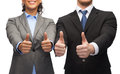 Businessman and businesswoman showing thumbs up Stock Photography