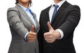 Businessman and businesswoman showing thumbs up business office concept Stock Photography
