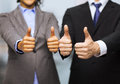 Businessman and businesswoman showing thumbs up business office concept in office Royalty Free Stock Photo