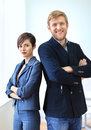 Businessman and businesswoman standing back to back with crossed Royalty Free Stock Photo