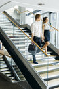 Businessman and businesswoman walking and taking stairs Royalty Free Stock Photo