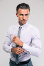 Businessman buttoning cuff sleeves confident isolated on a white background Royalty Free Stock Photos