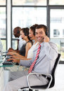 Businessman in a call center smiling at the camera Stock Photography