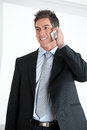Businessman on call at workplace handsome young using cellphone Stock Photography