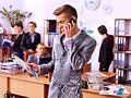 Businessman calling by mobile phone in office Stock Image