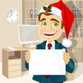 Businessman in cap of Santa Claus with poster Royalty Free Stock Photos