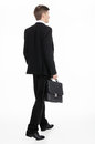 Businessman carrying a briefcase adult walking away Stock Photography