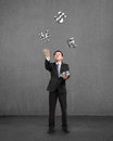 Businessman catching and throwing d sliver money symbols with concrete background Royalty Free Stock Photography