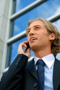 Businessman with a cell phone Stock Images